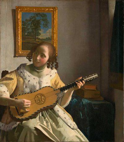 mujer tocando la guitarra de Vermeer